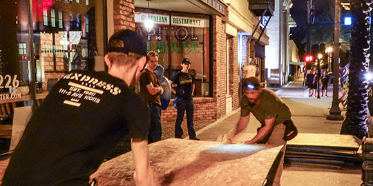 Voluneer Ministers boarding up and securing downtown Clearwater